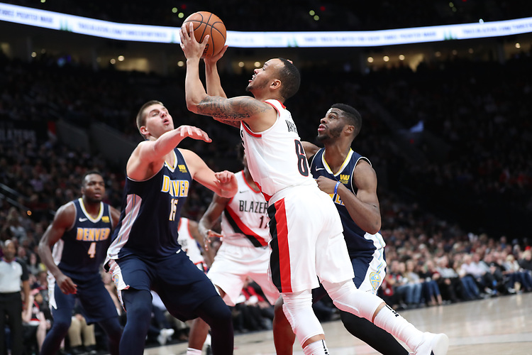 Portland Trail Blazers guard Shabazz Napier (6) shoots over Denver Nuggets center Nikola Jokic (15) and guard Emmanuel Mudiay (0) in the second half at Moda Center.<br /> Photo by Jaime Valdez