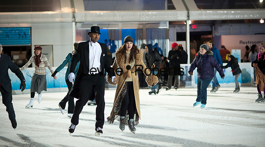Skaters dressed in formal attire maneuver the packed Pond at Bryant Park ice skating rink in New York on Thursday, January 19, 2012. Tourists and locals alike took to the ice at the free ice skating rink on a cold winter evening. (© Richard B. Levine)