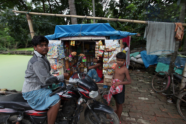 Small business in a rural village near Kolkata India...Photo by Matt Cashore/University of Notre Dame