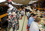 "Customers enjoy dinner aboard a ""Yakata-bune"" pleasure boat run by the Yasuda family in Tokyo, Japan on 30 August  2010. Photographer: Robert Gilhooly"
