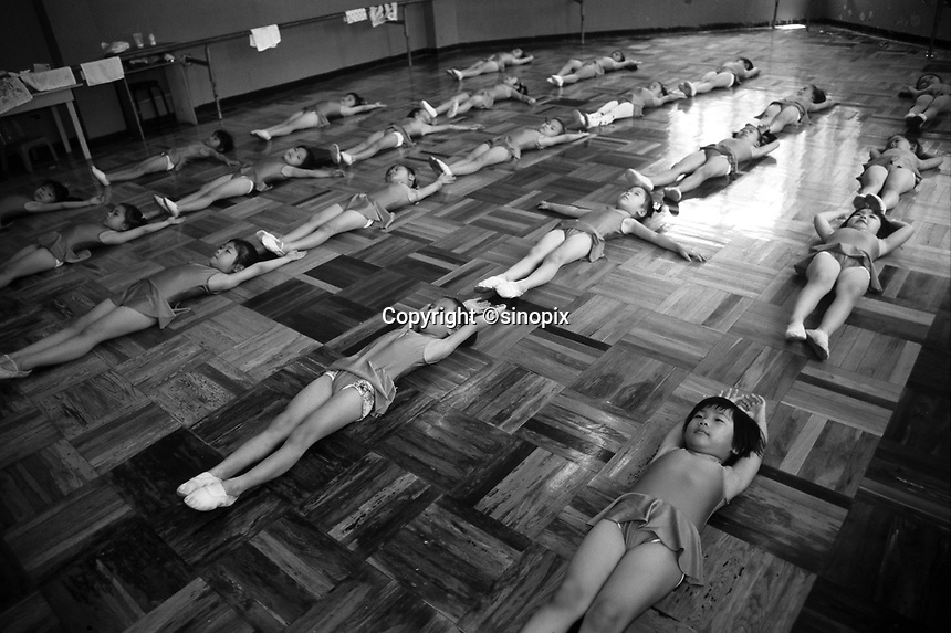Girls at ballet lesson at the &quot;Children's Palace&quot; in Shenzhen, China. The single children are doted upon are often referred to as &quot;Little Emperors&quot;.<br /> May 1999<br /> <br /> photo by Richard Jones / Sinopix