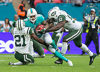04.10.2015. Wembley Stadium, London, England. NFL International Series. Miami Dolphins versus New York Jets. Miami Dolphins Wide Receiver Kenny Stills tackled by both New York Jets Free Safety Marcus Gilchrist and New York Jets Inside Linebacker David Harris.