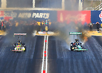 Feb 28, 2016; Chandler, AZ, USA; NHRA top fuel driver Leah Pritchett (right) races alongside J.R. Todd during the Carquest Nationals at Wild Horse Pass Motorsports Park. Mandatory Credit: Mark J. Rebilas-