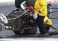 May 21, 2018; Topeka, KS, USA; NHRA safety safari rescue personnel tend to top alcohol dragster driver Steve Collier after he suffered a blowover crash during the Heartland Nationals at Heartland Motorsports Park. Collier was talking with safety personnel before being transported to a local hospital for an evaluation. Mandatory Credit: Mark J. Rebilas-USA TODAY Sports