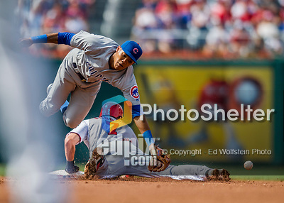 29 June 2017: Chicago Cubs infielder Addison Russell is unable to come up with the ball as Trea Turner steals second during game action against the Washington Nationals at Nationals Park in Washington, DC. The Cubs rallied to defeat the Nationals 5-4 and split their 4-game series. Mandatory Credit: Ed Wolfstein Photo *** RAW (NEF) Image File Available ***