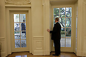 Washington, DC - October 8, 2009 -- A staff member prepares to open the door to the Oval Office for President Barack Obama following his statement on winning the 2009 Nobel Peace Prize in the Rose Garden of the White House, October 9, 2009. .Mandatory Credit: Pete Souza - White House via CNP