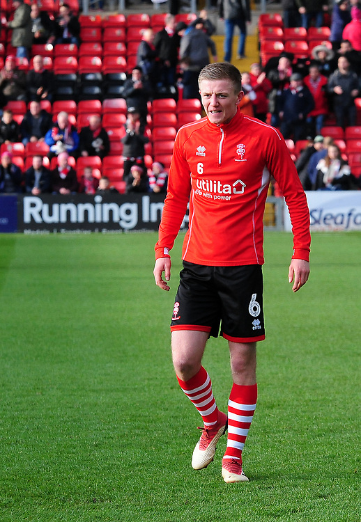 Lincoln City's Scott Wharton during the pre-match warm-up<br /> <br /> Photographer Andrew Vaughan/CameraSport<br /> <br /> The EFL Sky Bet League Two - Lincoln City v Mansfield Town - Saturday 24th November 2018 - Sincil Bank - Lincoln<br /> <br /> World Copyright © 2018 CameraSport. All rights reserved. 43 Linden Ave. Countesthorpe. Leicester. England. LE8 5PG - Tel: +44 (0) 116 277 4147 - admin@camerasport.com - www.camerasport.com