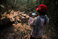 Loun Keuth, 23, records illegal activities in Prey Lang through the Prey Lang App. The Prey Lang App was developed to create a database on forest crimes. © Antoine Raab / Ruom