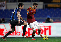 Calcio, semifinale di andata di Coppa Italia: Roma vs Inter. Roma, stadio Olimpico, 23 gennaio 2013..AS Roma forward Mattia Destro is challenged by FC Inter defender Andrea Ranocchia, left, during the Italy Cup football semifinal first half match between AS Roma and FC Inter at Rome's Olympic stadium, 23 January 2013..UPDATE IMAGES PRESS/Isabella Bonotto