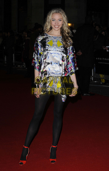 """Noelle Reno.attended the """"Arbitrage"""" UK film premiere, Odeon West End cinema, Leicester Square, London, England, UK, February 20th 2013..full length black  tights silver print shiny mini dress red sandals clutch bag bracelets yellow .CAP/CAN.©Can Nguyen/Capital Pictures."""