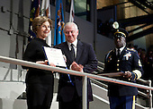 Arlington, VA - January 6, 2009 -- First lady Laura Bush receives the Secretary of Defense award for Outstanding Public Service from Robert Gates, Secretary of Defense, during the Military Appreciation Parade at Fort Myer in Arlington, Virginia, U.S. on Tuesday, January 6, 2009.    .Credit: Joshua Roberts - Pool via CNP