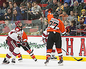 Mike Seward (Harvard - 18), Joe Grabowski (Princeton - 27) - The Harvard University Crimson defeated the visiting Princeton University Tigers 5-0 on Harvard's senior night on Saturday, February 28, 2015, at Bright-Landry Hockey Center in Boston, Massachusetts.