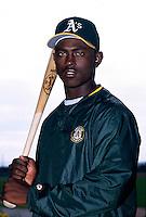 Mario Encarnacion of the Oakland Athletics at Phoenix Municipal Stadium in Phoenix, Arizona during 1996 Spring Training. (Larry Goren/Four Seam Images)