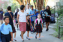 Children arrive to the International School of Louisiana in New Orleans, Friday, Aug. 28, 2015.