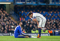 Thiago Silva of Paris Saint-Germain covers his face as Diego Costa of Chelsea goes down injured during the UEFA Champions League Round of 16 2nd leg match between Chelsea and PSG at Stamford Bridge, London, England on 9 March 2016. Photo by Andy Rowland.