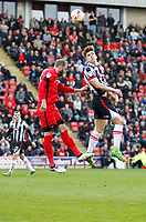 Grimsby Town's Sam Jones wins the header during the Sky Bet League 2 match between Leyton Orient and Grimsby Town at the Matchroom Stadium, London, England on 11 March 2017. Photo by Carlton Myrie / PRiME Media Images.