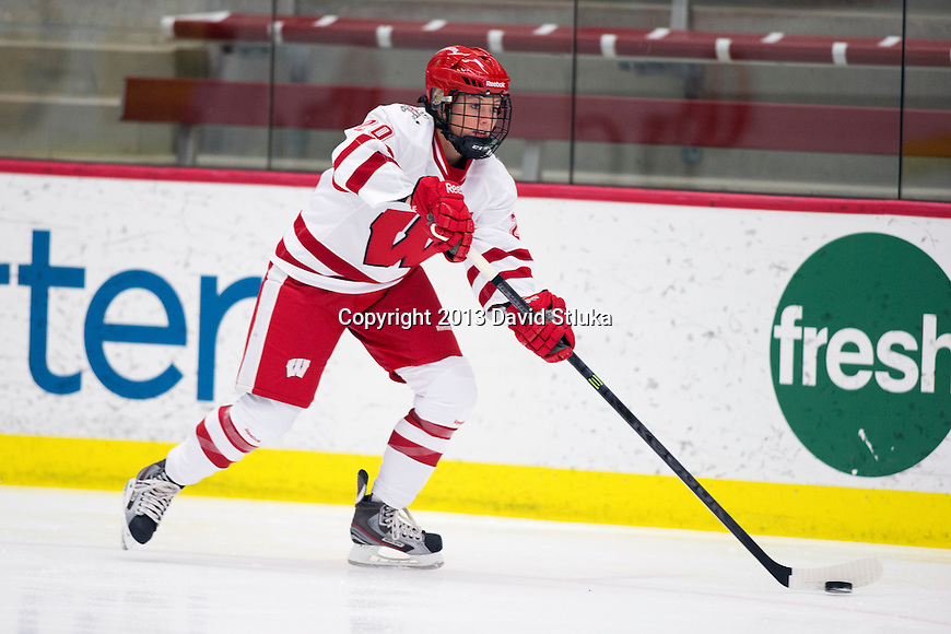 Wisconsin Badgers Mikayla Johnson (20) handles the puck during warmups prior to a game against Team Japan women's hockey exhibition in Madison, Wisconsin, on September 23, 2013. The Badgers won 3-0. (Photo by David Stluka)
