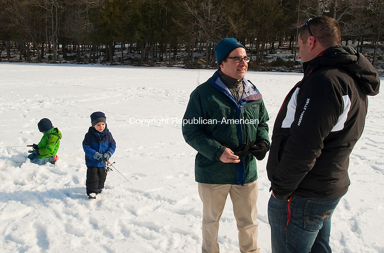 TORRINGTON, CT-020114JS02- Robert Klee, the new state Department of Energy and Environmental Services commissioner,  second from left, chats with Rep. ay Case (R-63)  during the eighth annual Winter festival at Burr Pond State Park in Torrington on Saturday. The event was hosted by the DEEP as part of their No Child Left Inside program. Klee was on the pond fishing with his sons Alexander, 6 and Jacob, 4. <br /> Jim Shannon Republican-American