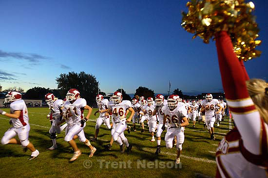 Viewmont high school football team takes the field, cheerleader<br />