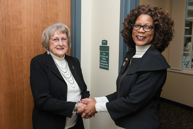 Dr. Ellen Goldsberry, left, and Dean Renee Middleton shake hands outside the new Distinguished Professorship room on the first floor of the newly renovated McCracken Hall on January 27, 2017.