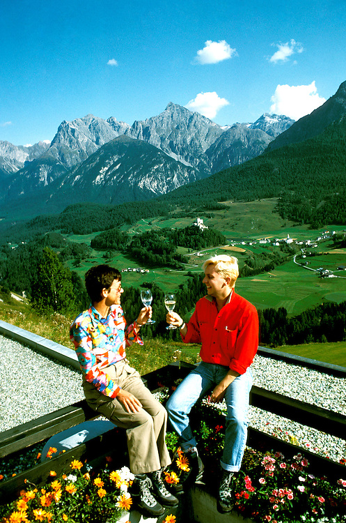 Switzerland: Couple above Tarasp Castle, Engadine, model released, photo: switze103 .Photo copyright Lee Foster, www.fostertravel.com, 510/549-2202, lee@fostertravel.com