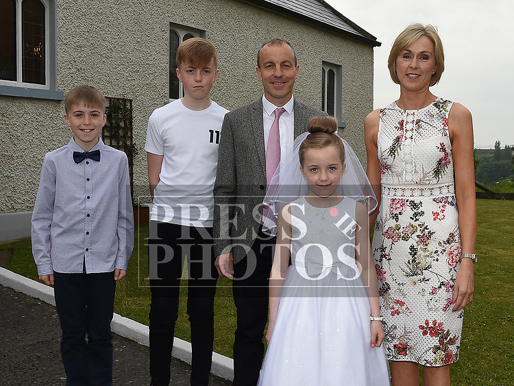 Maria Carton who received first holy communion in St Joseph's church Mell, pictured with her family. Photo:Colin Bell/pressphotos.ie
