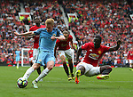 Kevin De Bruyne of Manchester City prepares to take shot as Eric Bailly of Manchester United jumps in to try and block during the Premier League match at Old Trafford Stadium, Manchester. Picture date: September 10th, 2016. Pic Simon Bellis/Sportimage