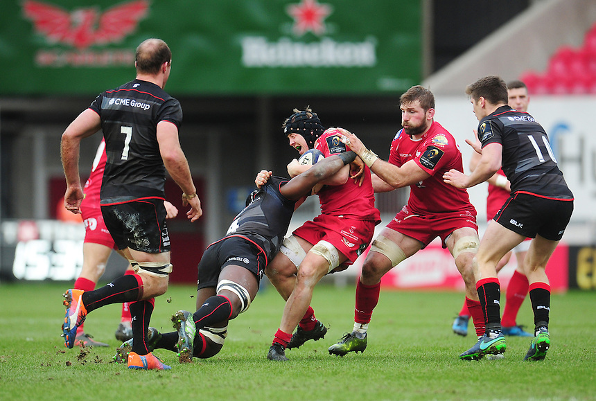 Scarlets' James Davies is tackled by Saracens' Maro Itoje<br /> <br /> Photographer Kevin Barnes/CameraSport<br /> <br /> European Rugby Champions Cup Pool 3 - Scarlets v Saracens - Sunday 15th January 2017 - Parc y Scarlets - Llanelli<br /> <br /> World Copyright &copy; 2016 CameraSport. All rights reserved. 43 Linden Ave. Countesthorpe. Leicester. England. LE8 5PG - Tel: +44 (0) 116 277 4147 - admin@camerasport.com - www.camerasport.com