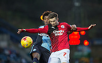 Gwion Edwards of Crawley Town holds off Sido Jombati of Wycombe Wanderers during the Sky Bet League 2 match between Wycombe Wanderers and Crawley Town at Adams Park, High Wycombe, England on 28 December 2015. Photo by Andy Rowland / PRiME Media Images