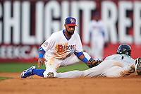 Buffalo Bisons shortstop Alexi Casilla (12) looks to tag Ozzie Martinez (1) sliding into second base during a game against the Norfolk Tides on July 18, 2016 at Coca-Cola Field in Buffalo, New York.  Norfolk defeated Buffalo 11-8.  (Mike Janes/Four Seam Images)