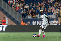FOXBOROUGH, MA - AUGUST 4: Wilfried Zahibo #23 of New England Revolution passes the ball during a game between Los Angeles FC and New England Revolution at Gillette Stadium on August 3, 2019 in Foxborough, Massachusetts.
