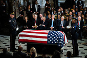 The American flag-draped casket of late United States Representative Elijah Cummings (Democrat of Maryland) sits in National Statuary Hall during a memorial service at the U.S. Capitol in Washington, D.C., U.S., on Thursday, Oct. 24, 2019. Cummings, a key figure in Democrats' impeachment inquiry and a fierce critic of US President Donald J. Trump, died at the age of 68 on October 17 due to complications concerning long-standing health challenges. Seated behind the casket, from left to right: Speaker of the US House of Representatives Nancy Pelosi (Democrat of California), US Senate Majority Leader Mitch McConnell (Republican of Kentucky), US Senate Minority Leader Chuck Schumer (Democrat of New York), US House Minority Leader Kevin McCarthy (Republican of California), US House Majority Leader Steny Hoyer (Democrat of Maryland), US House Assistant Democratic Leader James Clyburn (Democrat of South Carolina), and US Senator Ben Cardin (Democrat of Maryland).<br /> Credit: Al Drago / Pool via CNP