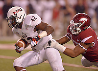 STAFF PHOTO BEN GOFF  @NWABenGoff -- 09/20/14 <br /> Arkansas defensive end Deatrich Wise, Jr. gets his hands on Northern Illinois tailback Cameron Stingily during the fourth quarter of the game against Northern Illinois in Reynolds Razorback Stadium in Fayetteville on Saturday September 20, 2014.