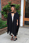 Full length portrait smiling young woman graduating, Goldsmiths College, University of London, England, UK