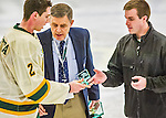 29 December 2013:  University of Vermont Catamount Defenseman Michael Paliotta, a Junior from Westport, CT, accepts the tournament MVP Award after the final game against the Canisius College Golden Griffins at Gutterson Fieldhouse in Burlington, Vermont. The Catamounts defeated the Golden Griffins 6-2 to capture the 2013 Sheraton/TD Bank Catamount Cup NCAA Hockey Tournament for the second straight year. Mandatory Credit: Ed Wolfstein Photo *** RAW (NEF) Image File Available ***