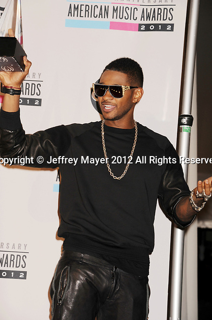 LOS ANGELES, CA - NOVEMBER 18: Usher  poses in the press room at the 40th Anniversary American Music Awards held at Nokia Theatre L.A. Live on November 18, 2012 in Los Angeles, California.