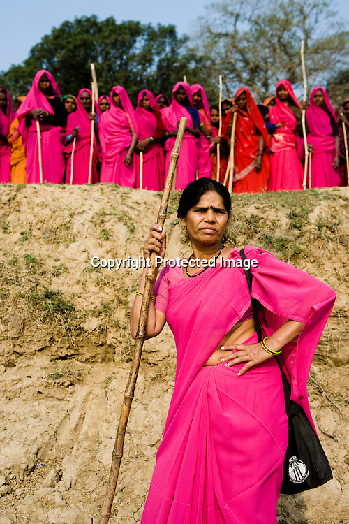 The 47-year-old leader of the Pink Gang, Sampat Pal Devi is a fiesty woman. The barely educated, impoverished mother of five, Sampat Pal Devi has emerged as a messianic figure in the region. Sampath Devi began to work as a government health worker, but she quit soon after because her job was not satisfying enough. She always wanted to work for the poor and not for herself. Taking up issues while being a government worker was difficult, so she decided to quit the job and work for the rights of people...Amidst the gloom of extreme poverty, it's the colour of pink that's calling the shots in this dusty region of Bundelkhand, one of the poorest parts of one of India's northern and most populous states, Uttar Pradesh in India. A gang of vigilantes, called the Gulabi Gang (pink gang) - its 10,000 strong women members wear only pink sarees - is taking up lathi (traditional Indian cudgel) against domestic violence and corruption.