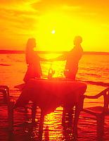 Couple on sunst beach,Sky,seascapes,dramatic,sun rises,sun sets,clouds