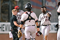 Hickory Crawdads trainer Sean Fields tends to third baseman Juremi Profar (23) after taking a ball in the head from a bad bounce during game 3 of the South Atlantic League Championship Series between the Asheville Tourists and the Hickory Crawdads on September 17, 2015 in Asheville, North Carolina. The Crawdads defeated the Tourists 5-1 to win the championship. (Tony Farlow/Four Seam Images)