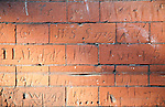 Eighteenth century children's graffiti scratched into red brick of former school building, Dedham, Essex, England