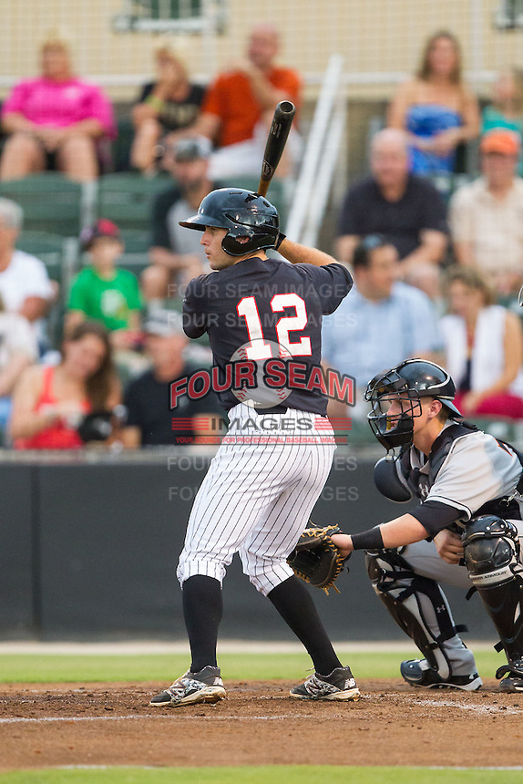 Ryan Leonards (12) of the Kannapolis Intimidators at bat against the Delmarva Shorebirds at CMC-NorthEast Stadium on July 3, 2014 in Kannapolis, North Carolina.  The Shorebirds defeated the Intimidators 6-5. (Brian Westerholt/Four Seam Images)