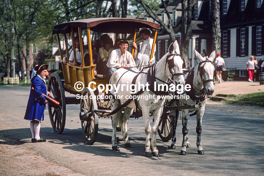Visitors tour the Colonial Williamsburg Historic Area, the restored capital of 18th century Virginia, in a horse-drawn carriage. 19880505CW6..Copyright Image from Victor Patterson, 54 Dorchester Park, Belfast, UK, BT9 6RJ..Tel: +44 28 9066 1296.Mob: +44 7802 353836.Voicemail +44 20 8816 7153.Skype: victorpattersonbelfast.Email: victorpatterson@me.com.Email: victorpatterson@ireland.com (back-up)..IMPORTANT: If you wish to use this image or any other of my images please go to www.victorpatterson.com and click on the Terms & Conditions. Then contact me by email or phone with the reference number(s) of the image(s) concerned.