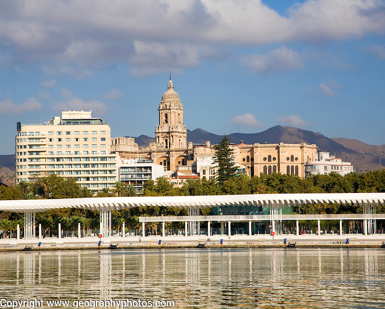 View over the new port development looking towards the city centre and  historic buildings around the cathedral, Malaga, Spain