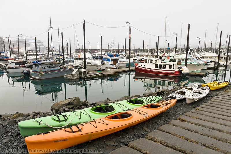 Sea kayaks, the Whittier boat harbor, Whittier, Alaska.