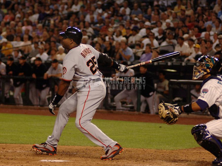 Apr 18, 2006; Phoenix, AZ, USA; San Francisco Giants left fielder (25) Barry Bonds hits a double against the Arizona Diamondbacks at Chase Field in Phoenix, AZ. Mandatory Credit: Mark J. Rebilas