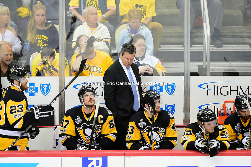 June 8, 2017: Pittsburgh Penguins head coach Mike Sullivan reacts to game play during game five of the National Hockey League Stanley Cup Finals between the Nashville Predators  and the Pittsburgh Penguins, held at PPG Paints Arena, in Pittsburgh, PA. Pittsburgh defeats Nashville 6-0 to lead the series 3-2. Eric Canha/CSM