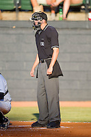 Travis Eggert handles the home plate duties during an Appalachian League game between the Greeneville Astros and the Bristol White Sox at Boyce Cox Field July 2, 2010, in Bristol, Tennessee.  Photo by Brian Westerholt / Four Seam Images