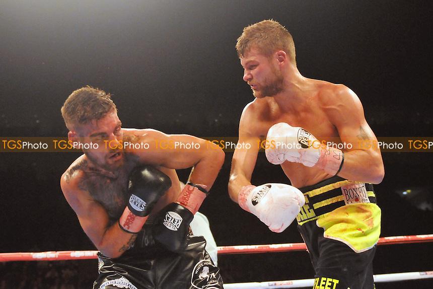John Wayne Hibbert (black/yellow shorts) defeats Tyler Goodjohn - Boxing at the O2 Arena, London, promoted by Matchroom Sports - 31/01/15 - MANDATORY CREDIT: Philip Sharkey/TGSPHOTO - Self billing applies where appropriate - contact@tgsphoto.co.uk - NO UNPAID USE
