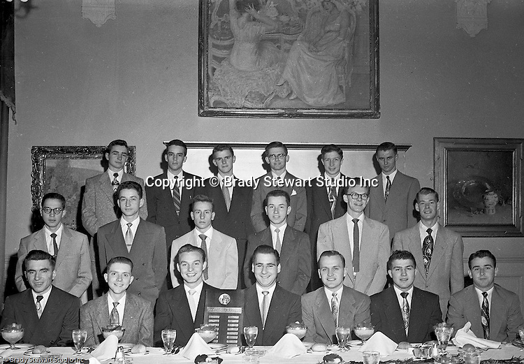 Pittsburgh PA:  View of the Caddies receiving college scholarships from the Western Pennsylvania Golf Association's Caddie Welfare Foundation for year 1952.  The Foundation was managed by Fidelity Trust Company and scholarships are agreed upon by the WPGA executive committee. This dinner was held at the University Club in Pittsburgh and the assignment was for Charles K. Robinson. The mission of the WPGA are to sanction championships, establish handicapping and rate area golf courses.