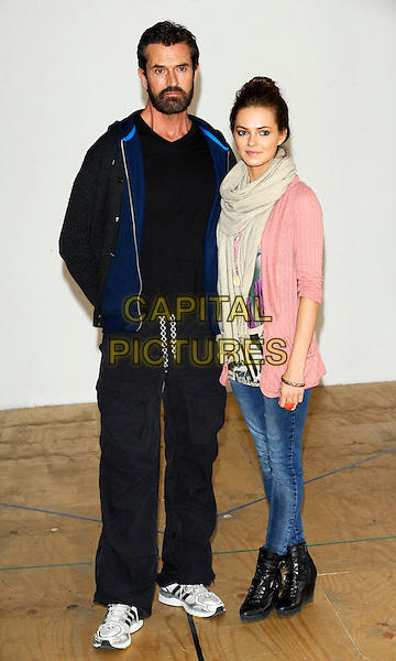 "RUPERT EVERETT & KARA TOINTON.On the first day of rehearsals of the West End production of ""Pygmalion"", Menier Chocolate Factory, London, England..April 12th, 2011.full length cardigan jeans denim ankle boots tracksuit blue black beard facial hair scarf beige pink hair up .CAP/CJ.©Chris Joseph/Capital Pictures."
